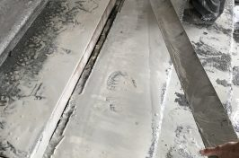 Close up of steps being worked on by an employee